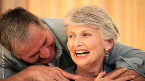 Mature couple embracing and speaking to each other