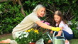 Woman and daughter doing some gardening