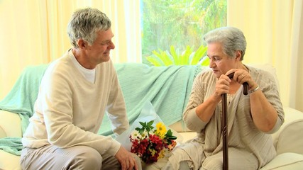 Mature man visiting his wife in hospital