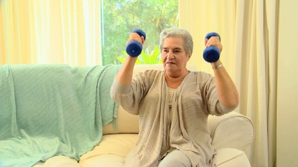 Mature woman exercising her arms