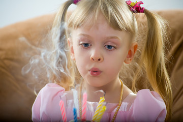 Blowing on a birthday candle