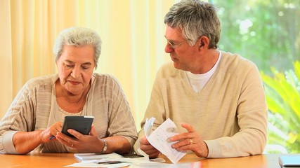 Mature couple sorting out their accounts