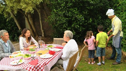 Family and grandparents having a barbecue