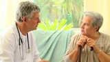 Mature woman patient talking with her doctor