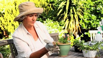 Retired woman potting plants