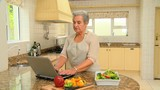 Mature woman looking up a new recipe