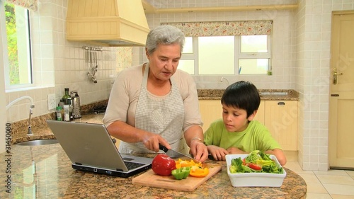 Woman showing her grandson how to cook