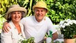 Mature couple wearing sun-hats posing outdoors for a photo