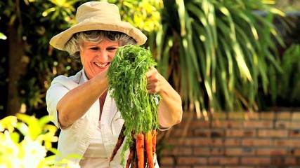 Mature woman with carrots
