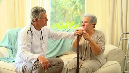 Doctor reassuring his patient