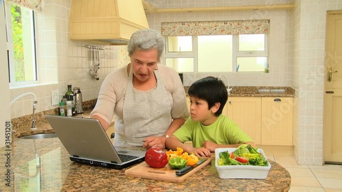 Woman teaching grandson to cook