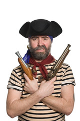 Bearded pirate in tricorn hat with a muskets