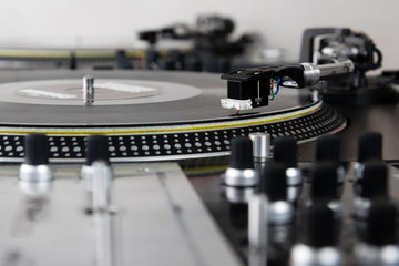 Turntable playing vinyl music record