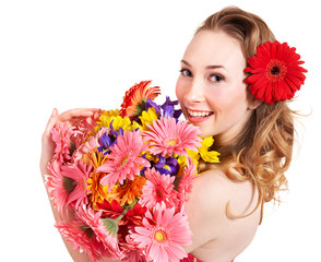 Young woman holding flowers.