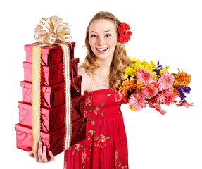 Young woman holding gift box and flowers.