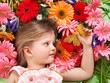Cute child lying on the flower.