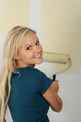 Pretty Woman with Paint Roller