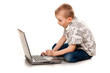 Cute boy playing with laptop