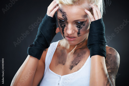 Depressed girl with dirt on her face, closeup