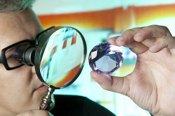 Jeweller appraising quality of diamond