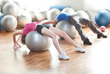 Training - couple on pilates stability balls