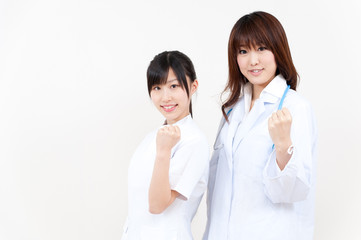 two beautiful asian doctors cheering