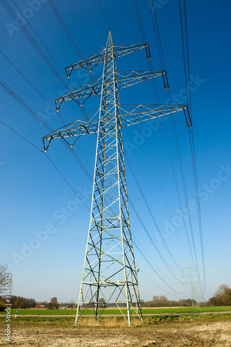 Electricity transmission pylon with blue sky on the background