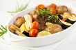Rustic roast pork with baked vegetables and rosemary