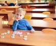 Kid playing in kindergarten