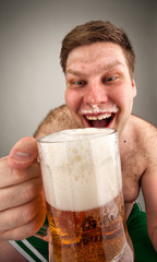 Funny fat man drinking beer