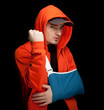 furious man with broken hand wearing an arm brace