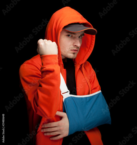 furious man with broken hand wearing an arm brace