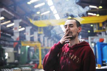 industry worker smoke cigarette