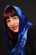 Woman with scarf headwear