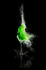 Glass with green liquid exploded