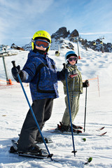 Children on the snowy ski slopes