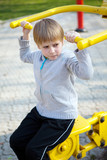 The small child hanging on a training apparatus poster