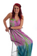 Beautiful young woman in colourful dress isolated