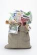 Leinwanddruck Bild - Geldsack mit Euro- Scheinen