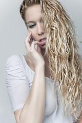 sensual blond girl in wet shirt