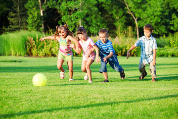 Kids group playing with ball