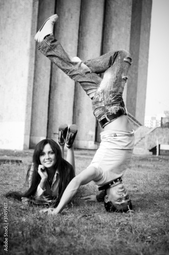 photo of business woman and street dancer