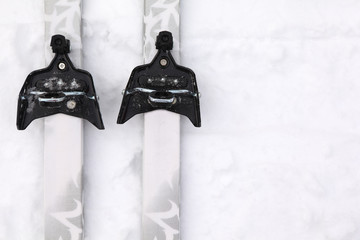 Pair of cross-country skis with simple binding on snow
