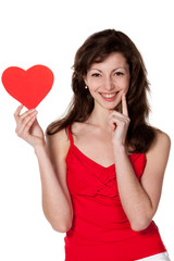 Young female holding heart shape isolated on white background
