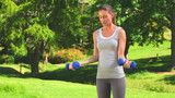 Cute woman doing musculation exercises