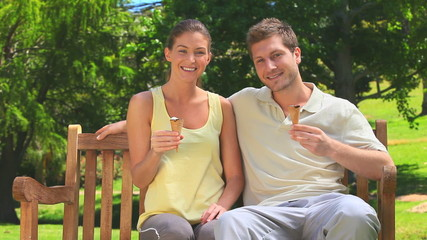 Attractive couple eating ice creams