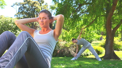 Athletic couple excersising outdoors