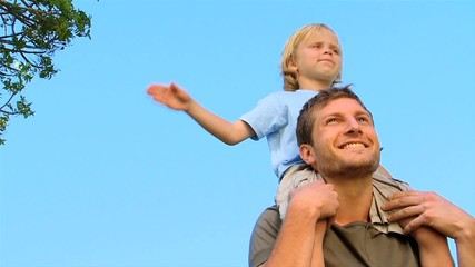Son on his father's shoulders