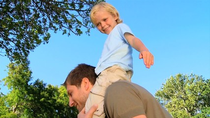 Father with his son on his shoulders