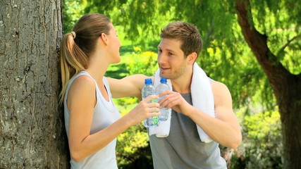 Athletic couple having a drink of water